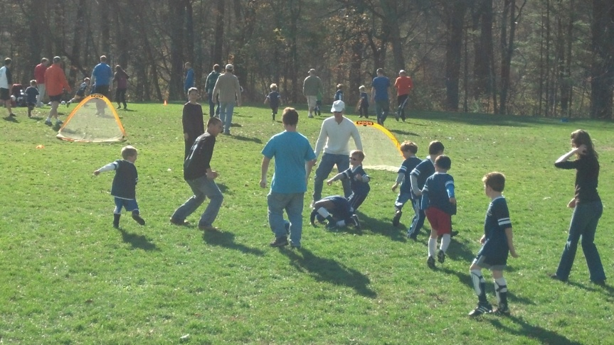 On the last day of the First Grade Soccer season, all the adults get to play a game with the kids.