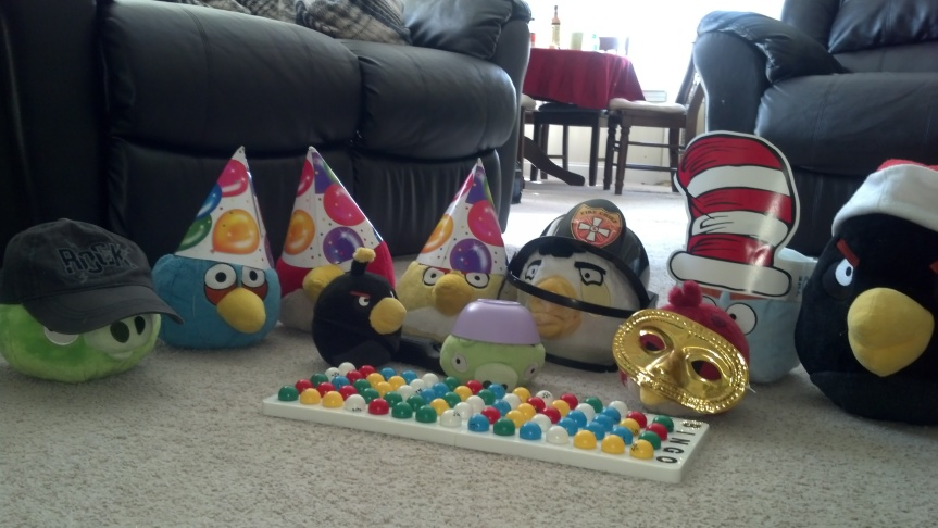 "My son enjoys having ""parties"" with his Angry Birds toys. Today they're playing Bingo."
