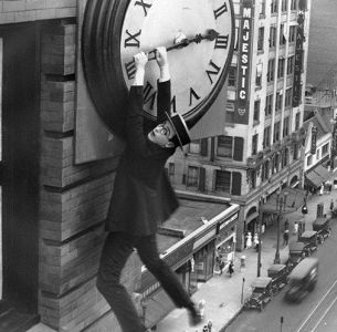 Man hanging from clock